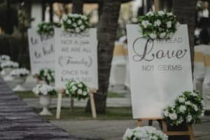 White wedding signs with floral accents